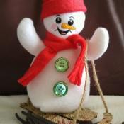 snowman-on-sled-30788a7bcf4034835bf66f396b94049b1ef441ef